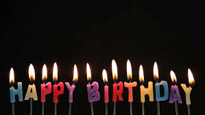 happy birthday candle happy birthday candles being blown out on black background stock