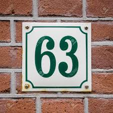 green house number sixty three on an enameled plate stock photo