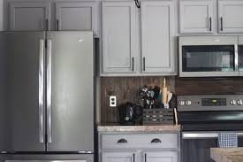 white kitchen cabinets with black slate appliances why i chose slate appliances stainless steel in my new home