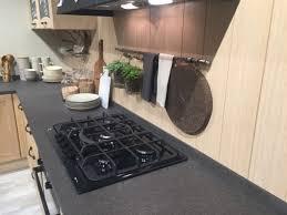 smart countertop wood plank backsplash light flooring wallmounted cabinets cutting