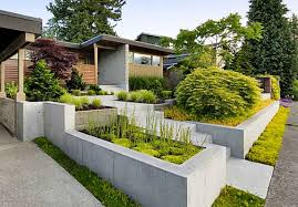 front yard landscape with wooden fence ideas and green foliages