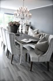 Rustic Dining Rooms by Grey Rustic Dining Table With Beautiful Fabric Chairs The
