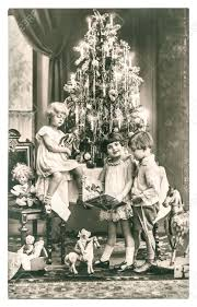 happy kids with christmas tree gifts and vintage toys antique