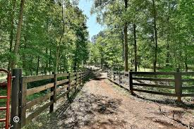 60 acre property with barna log home and horse stables in pine