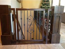 Baby Gate For Bottom Of Stairs Banisters The Wrought Iron Motif Of The Hand Railing Is Repeated In This