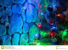 christmas tree and stone wall stock photo image 59880732