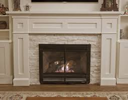 decor stacked stone tile fireplace surround and ventless