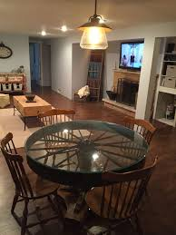 repurposed table top ideas table made from tree trunk stump wagon wheel and glass must have