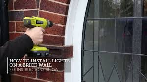 hanging christmas lights on brick walls how to install lights on a brick wall youtube