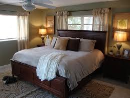 bedroom decor wooden platform bed headboard ceiling fan bedside