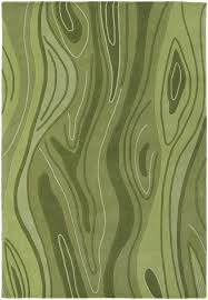inhabit collection tufted area rug green wood grain design