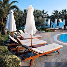 beautiful lounges near the pool u2014 stock photo vladitto 3249148