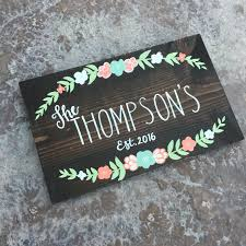 custom family name sign with established date and flowers wedding