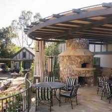 covered patio with rustic fireplace pizza oven patio design
