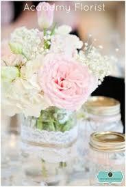 jar arrangements jar and wood slice centerpieces wedding ideas
