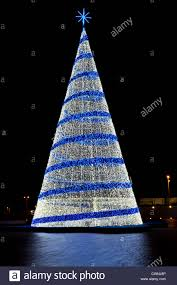 pine christmas tree figure with blue and white lights against a