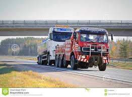 volvo heavy duty trucks tank truck being towed by a heavy duty tow truck editorial stock