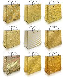 gold gift bags nine gold gift bag isolated on white background stock photo