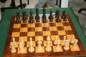 large resin chess set on wood inlay board exeter chess club