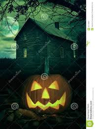 halloween pumpkin in front of a spooky house royalty free stock