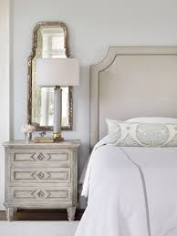 love the look bedroom pinterest bedrooms master bedroom traditional master bedroom boasts a gray headboard on bed with white and gray bedding and a gray leaf print lumbar pillow next to a gray nightstand and an