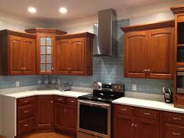 vapor glass subway tile kitchen backsplash with wood cabinets