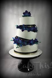3 tier topsy turvy wedding cake with blue singapore orchids