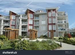 contemporary condominium building suburban setting stock photo