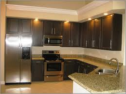 kitchen style espresso cabinets beige kitchen painted wall