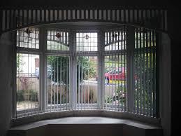 wooden emmaus dining room web white venetian blinds bay window