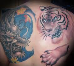 dragon tattoo on arm and shoulder dark dragon tattoo designs for boy