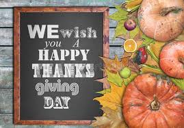 wooden frame and we wish you a happy thanksgiving day stock photo