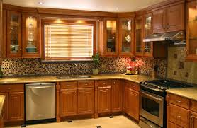 tuscan kitchen with wooden oak cabinets and hanging chandeliers