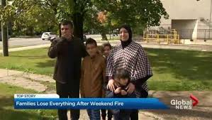 refugee family devastated by townhouse receives thanksgiving
