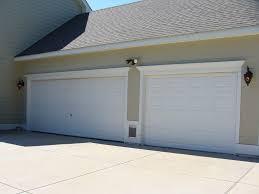 St Louis Garage Door arctic white crown moulding and trim on garage sandstone beige