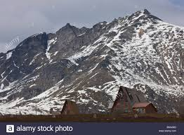 a frame chalet at hatcher pass with the last of the spring snow on