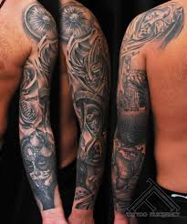 mexican style detailed black and white tattoo with masks and