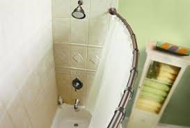 the adjustable moen curved shower rod in world bronze is in