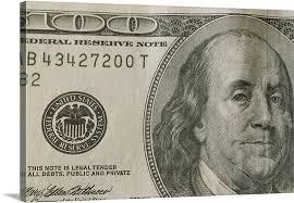portrait of benjamin franklin on the one hundred dollar bill wall