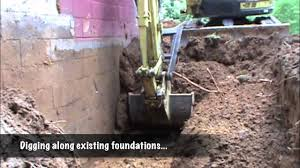 excavation for new foundations to repair existing foundations