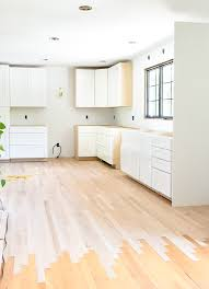 white shaker kitchen cabinets wood floors week 10 renovation update cabinets empty house tour new
