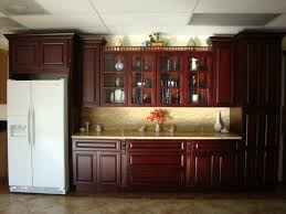 red cherry wood pantry cabinet combined white refrigerator
