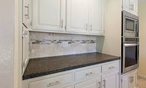 kitchen backsplash accent tile striking white kitchen cabinet colors with black granite top added