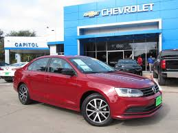 red volkswagen jetta pre owned 2016 volkswagen jetta sedan 1 4t se 4dr car in austin