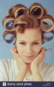 curl in front of hair pic female dark blonde hair set in very large rollers curl loose in