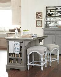 the kitchen island with stainless wrapped metal top by paula deen