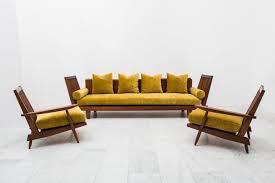 george nakashima unique suite of black walnut furniture including