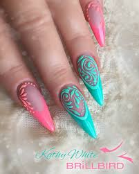 pink and green soft stiletto nails with sugaring design using