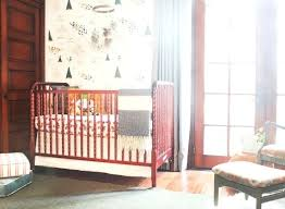 eclectic nursery decor design reveal warm and eclectic nursery