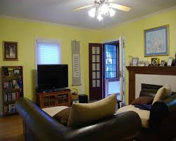 charming yellow paint color for living room with white window and